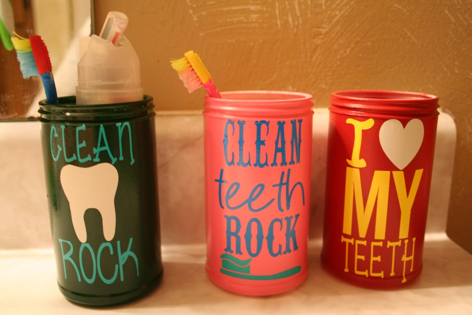 Upcycled Old Orchard Juice Cans into Toothbrush Holders