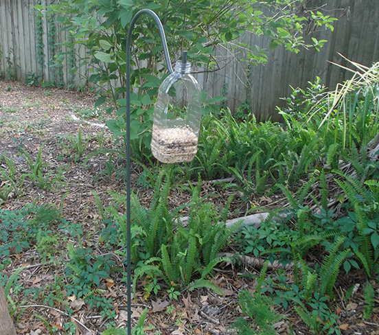 Upcycled Old Orchard Juice Bottle into a Bird Feeder
