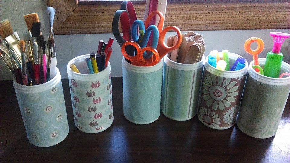 Upcycled Old Orchard frozen juice cans into art supplies containers
